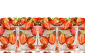 Strawberry by halves in glass with ice — Stock Photo