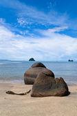 Beautiful black sand beach with boulders — Stock Photo