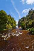 Beautiful brown volcanic river — Stock Photo