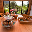 Stock Photo: Kitchen table with muffins