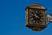 Ancient Clock Over A Blue Sky — Stock Photo