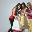 Young women looking happy shopping bags — Stock Photo #5545184