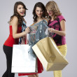 Young women looking happy shopping bags — Stock Photo