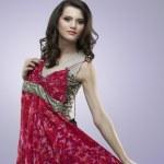 Happy women trying red flower dress — Stock Photo #5545215