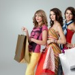 Girlfriends smiling shopping — Stock Photo #5663628