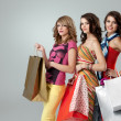 Girlfriends smiling shopping — Stock Photo