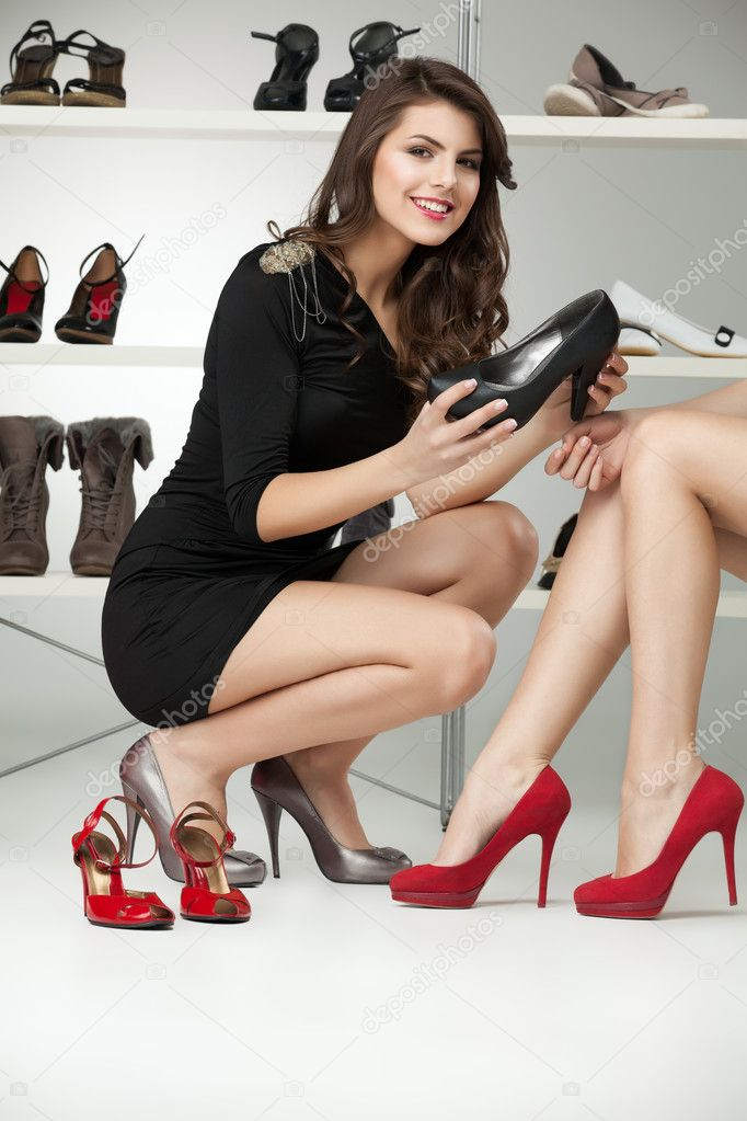 Two young women trying on high heels  Stock Photo #5663639