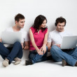 Curious friends looking at laptop — Stock Photo