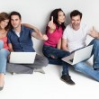 Friends aprooving laptops smiling - Stock Photo