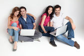 Carfree friends with laptops — Stock Photo