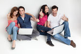 Friends aprooving laptops smiling — Stock Photo