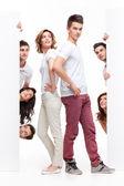 Joven pareja y amigos publicidad — Foto de Stock