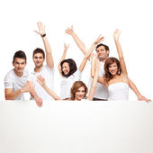 Enthusiastic friends advertising white board — Stock Photo