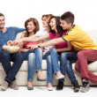 Friends reaching for the popcorn — Stock Photo