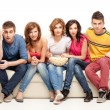 Young group of friends watching questioning movie - Stock Photo