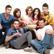 Friends sitting comfortable with popcorn — Stock Photo