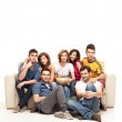 Young casual friends watching television — Stock Photo
