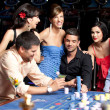 Young beautiful having fun at the casino — Stock Photo