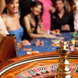 Group of young playing roulette - Stock Photo