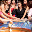 Winning roulette friends — Stock Photo