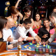 Excitement over roulette playing - Stock Photo