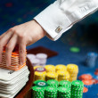 Hand of a poker dealer — Stock Photo