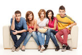 Young group of friends watching questioning movie — Stock Photo