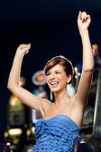 Glamourous woman celebrating winning — Stock Photo
