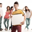 Young man holding blank banner — Stock Photo #6078646
