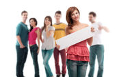 Young woman with blank ad banner — Stock Photo