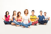 Young casual at yoga course — Stock Photo