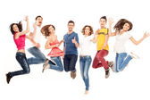 Young friends jumping high — Stock Photo