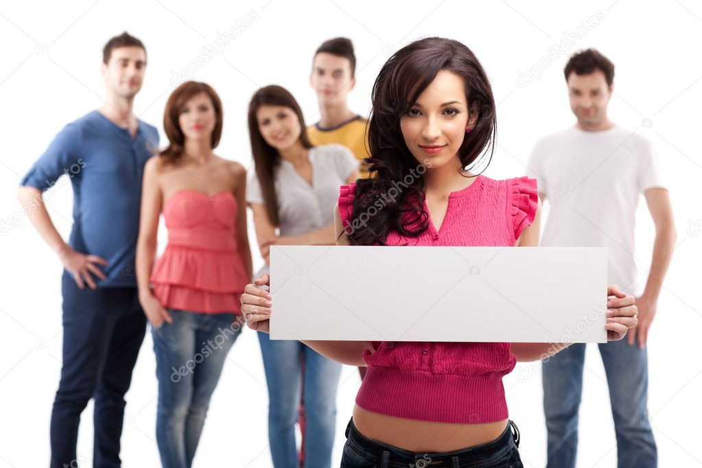 Young brunette woman holding blank advertising banner  Stock Photo #6078642