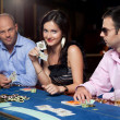 Poker players at table - Stock Photo