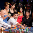 Roulette players - Stock Photo