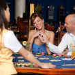 Couple playing blackjack - Stock Photo