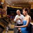 Stock Photo: Coversation by the slot machine