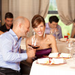 Young couple laughing  restaurant - Stock Photo