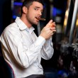 Casino player smoking cigar — Stock Photo