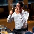 Casino player smoking — Stock Photo
