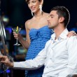 Slot machine playing couple — Stock Photo #6111125
