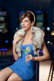 Young beautiful woman at the casino — Stock Photo