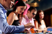 Poker players at the table — Stock Photo