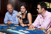 Poker players at table — Stock Photo