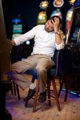 Man gambling at slot machine — Stock Photo