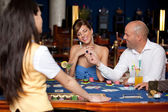 Couple playing blackjack — Stock Photo