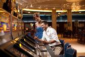 Happy slot machine playing — Stock Photo