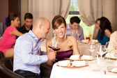 Young couple laughing restaurant — Stock Photo