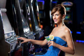 Young woman with cocktail in a casino — Stock Photo