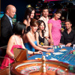 Glamourous roulette players — Stock Photo